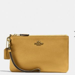 Coach- pebbled leather wristlet- yellow